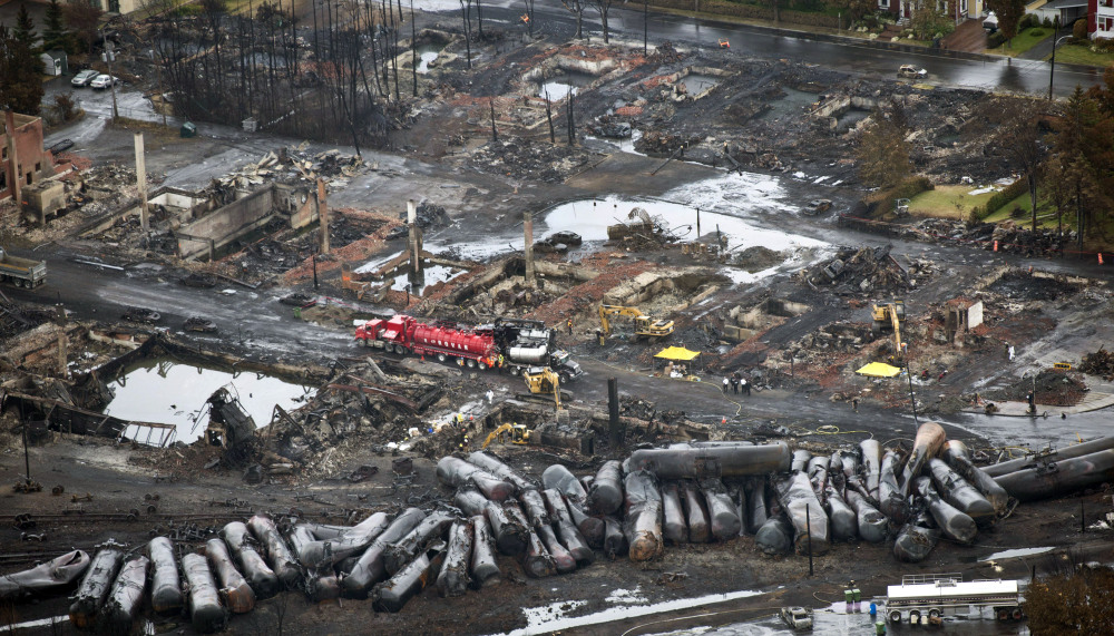 Workers comb through debris in Lac-Megantic, Quebec, on July 9, three days after an unmanned train with 72 railway cars carrying crude oil derailed, causing explosions that killed 47 people. The Canadian town is 10 miles from Maine's northwestern border.