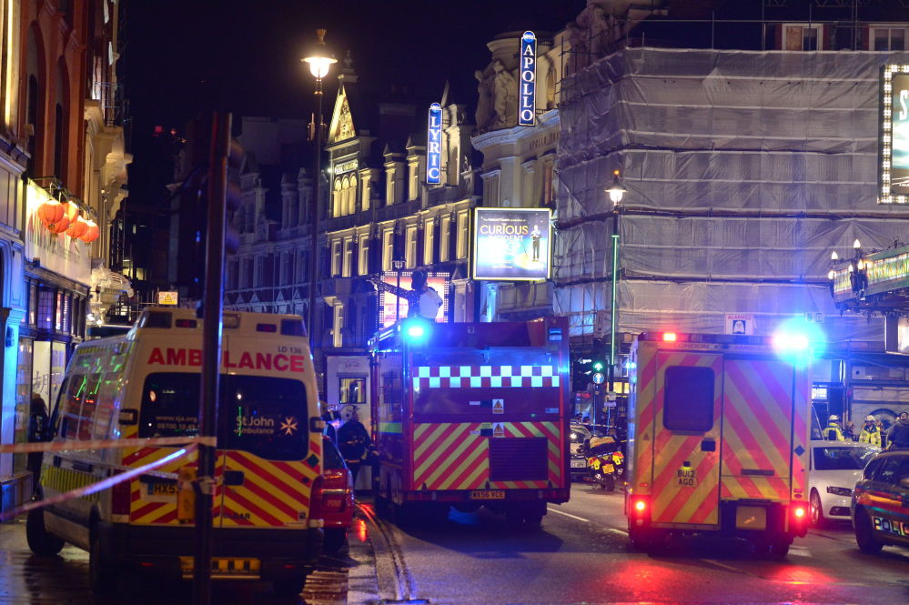 Emergency services attend the scene at the Apollo Theatre in central London.