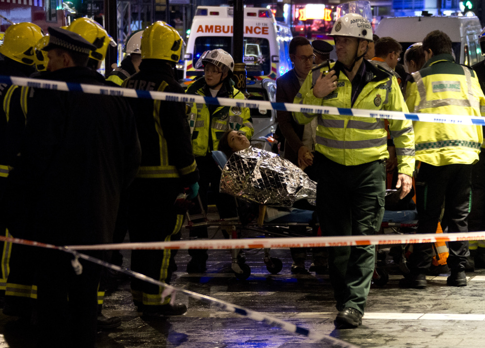 """A woman lies on a stretcher surrounded by rescue workers, awaiting evacuation following an incident during a performance at the Apollo Theatre, in London's Shaftesbury Avenue, Thursday evening, Dec. 19, 2013, with police saying there were """"a number"""" of casualties. It wasn't immediately clear which part of the building had collapsed. The London Fire Brigade said the theatre was almost full, with around 700 people watching the performance. A spokesman added: """"It's thought between 20 and 40 people were injured."""""""