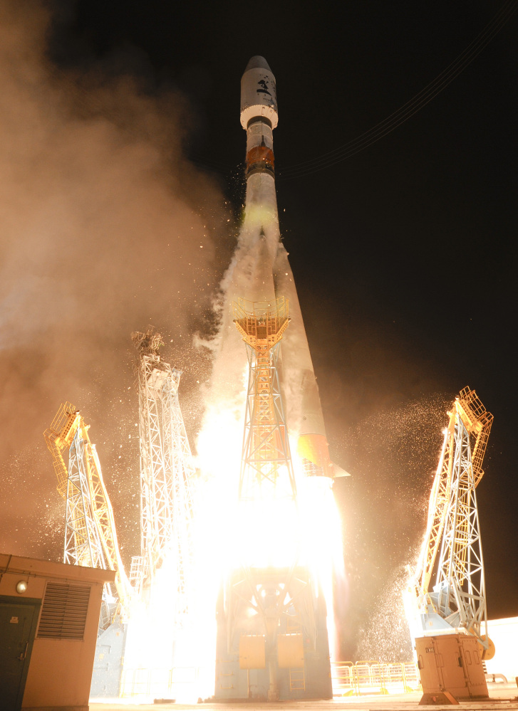 A Soyuz rocket carrying a European Space Agency satellite taking off from the Kourou space base, French Guiana, Thursday Dec.19, 2013. AP Photo