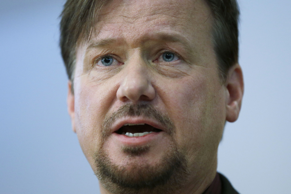 The Rev. Frank Schaefer, a United Methodist clergyman convicted of breaking church law for officiating at his son's same-sex wedding, speaks at a news conference on Monday in Philadelphia, where he vowed to defy a church order to surrender his credentials for performing a same-sex wedding.