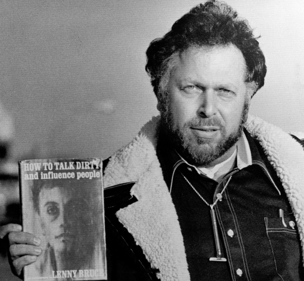 Al Goldstein displays some of his reading material upon leaving the federal courthouse in Kansas City, Kan., where his obscenity trial was held in 1977.