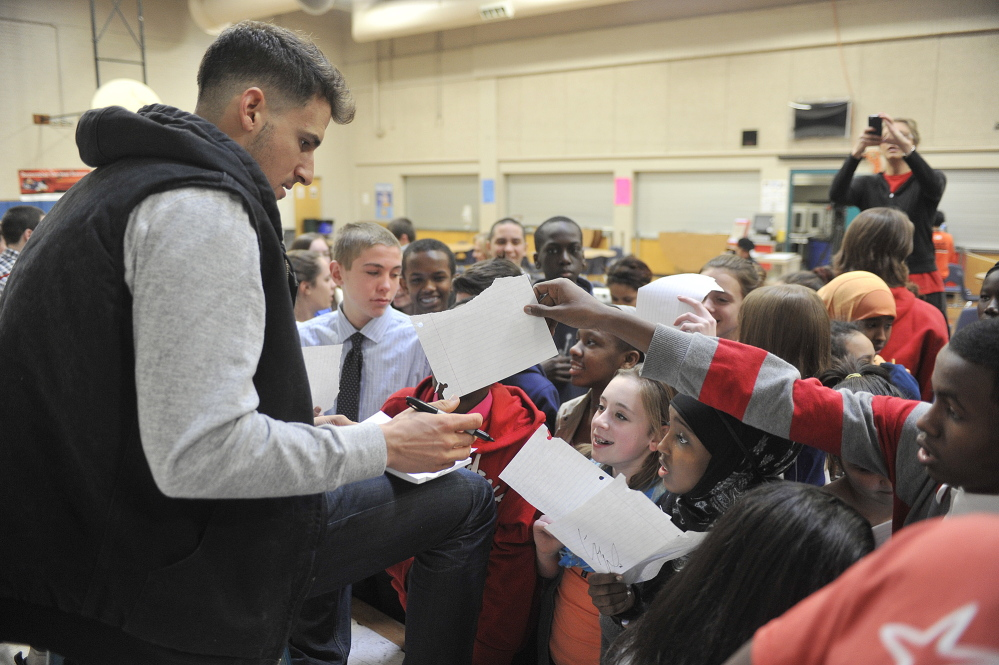 Portland native Ryan Flaherty of the Baltimore Orioles signs autographs for students at Lyman Moore Middle School after talking about his baseball career Thursday.