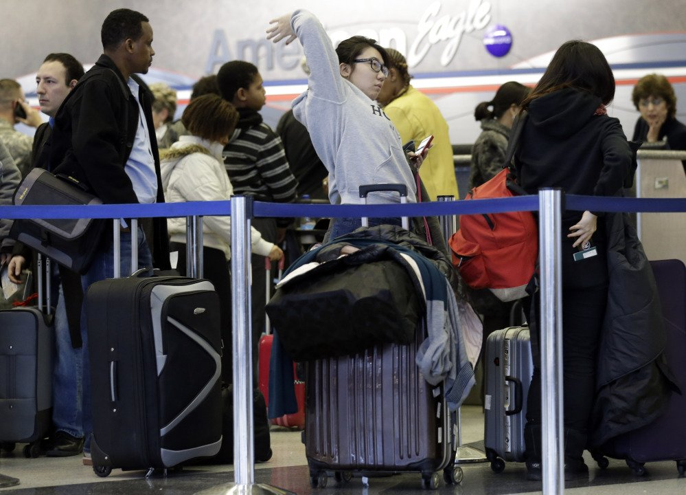 Passengers line up at ticket counters inside Terminal 3 at O'Hare International Airport in Chicago on Friday. Chicago was among three airports dealing with most of Friday's delayed flights.