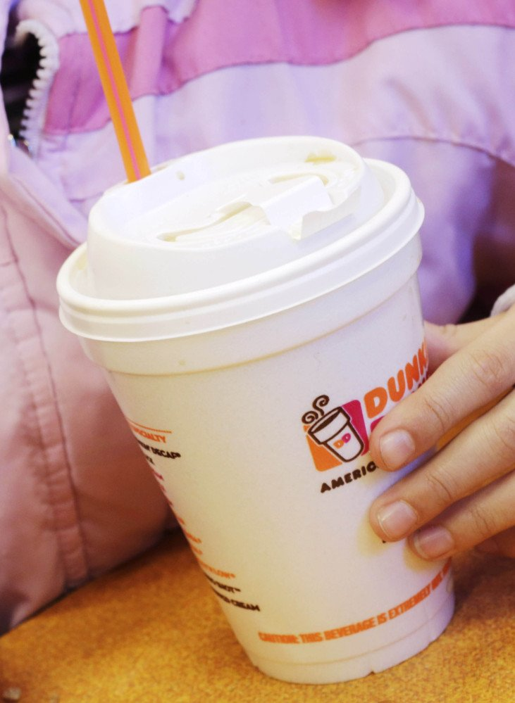 "Containers like this Dunkin' Donuts coffee cup made of a petrochemical called expanded polystyrene are scheduled to be banned in New York. Mayor Bloomberg wants them to ""go the way of lead paint."""