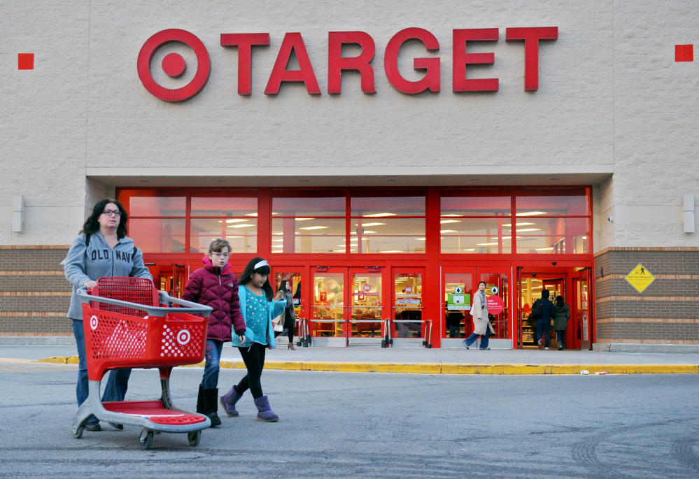 Shoppers leave a retail Target on Thursday in Hackensack, N.J. Target says that about 40 million credit and debit card accounts customers may have been affected by a data breach that occurred at its U.S. stores between Nov. 27 and Dec. 15.