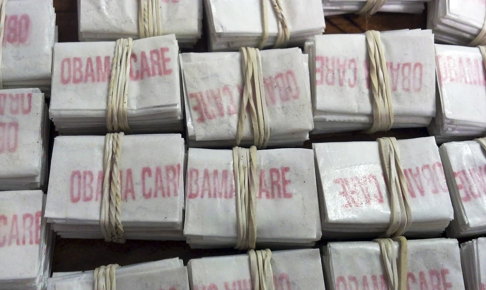 "Packets of heroin labeled ""Obamacare"" and ""Kurt Cobain,"" which troopers confiscated in Hatfield, Mass., are shown in a photo released by Massachusetts State Police on Friday."