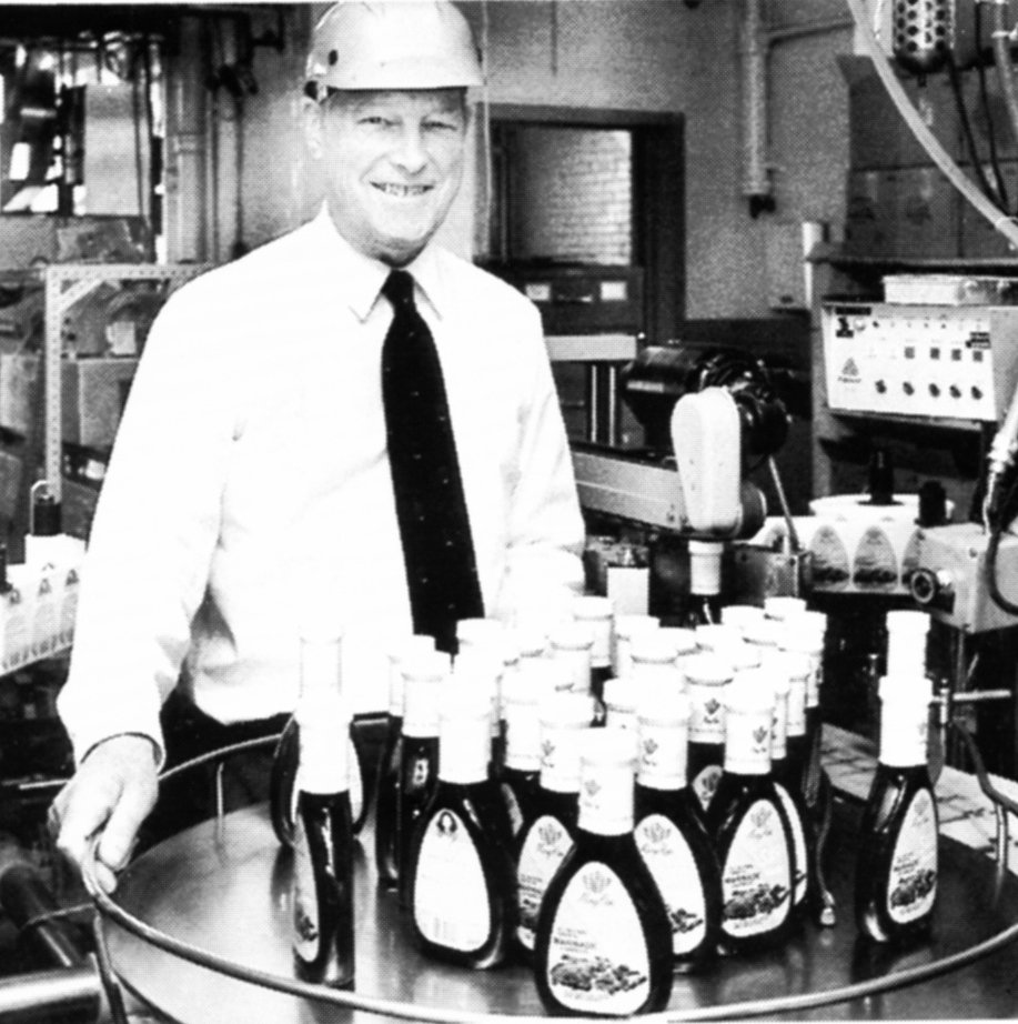 Richard Foss poses with some of the products made by the company he co-owned, Schlotter-beck & Foss. He was also active in First Parish Church of Portland.