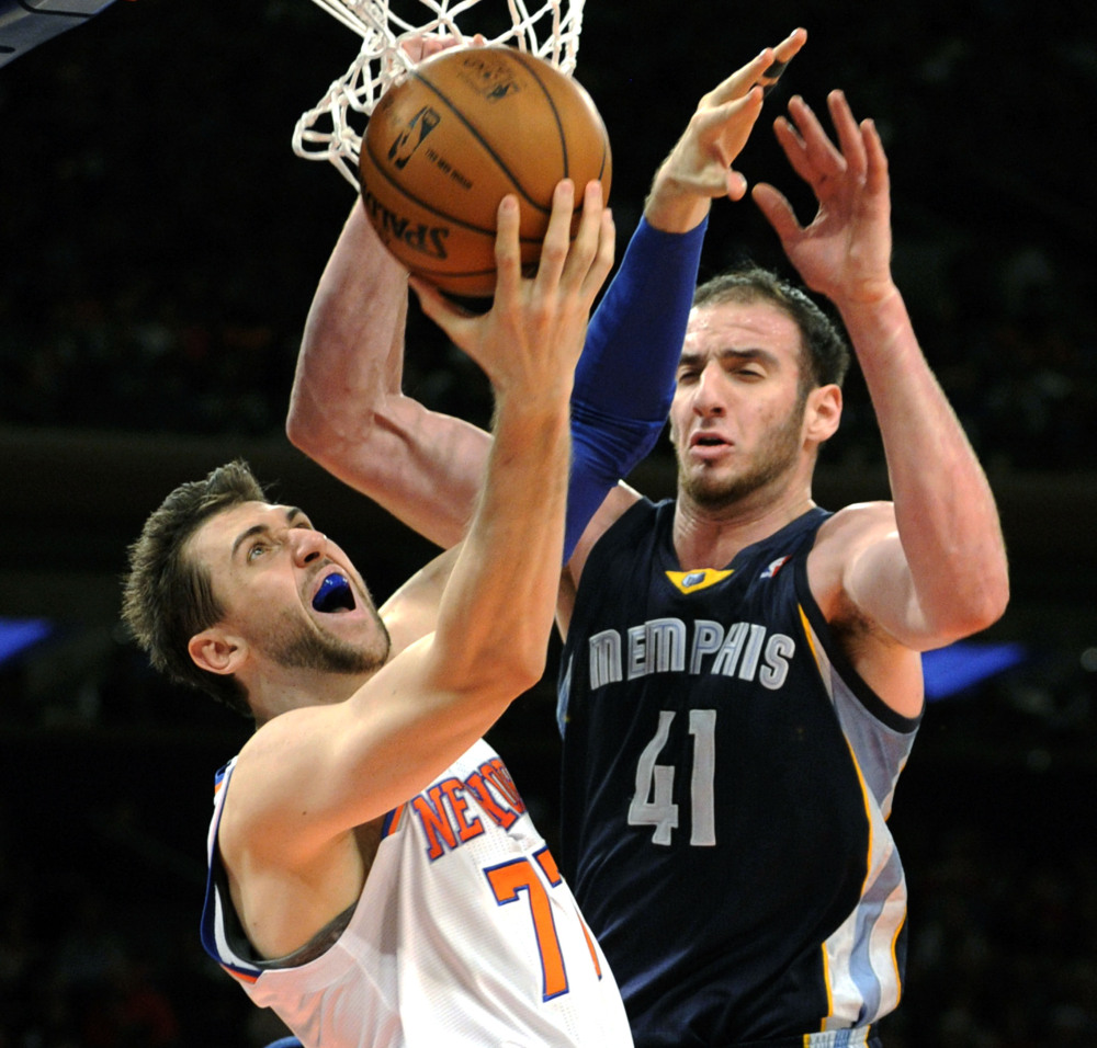 Andrea Bargnani of the New York Knicks goes up for a shot Saturday while guarded by Kosta Koufos of the Memphis Grizzlies in the second quarter of Memphis' 95-87 victory.
