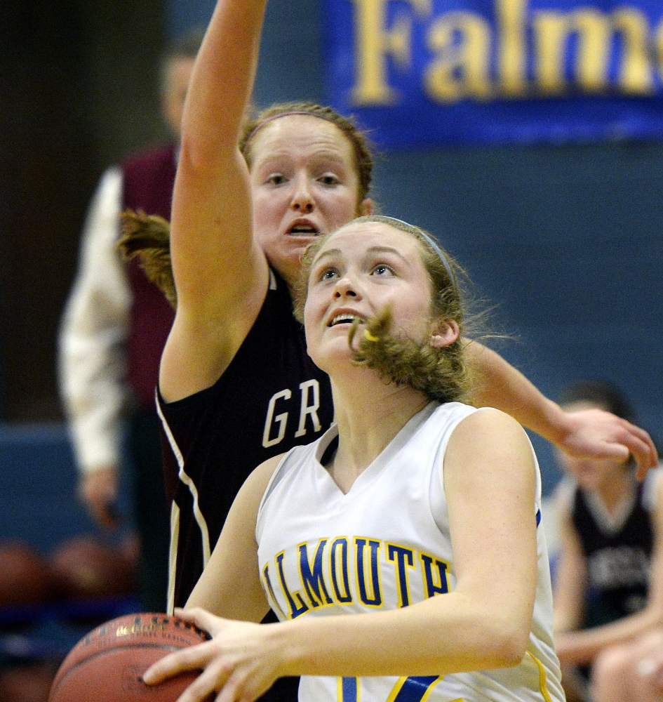 Emma Powers of Falmouth drives to the basket as Greely's Haley Felkel defends during their Western Maine Conference basketball game Saturday. Falmouth won, 53-45.