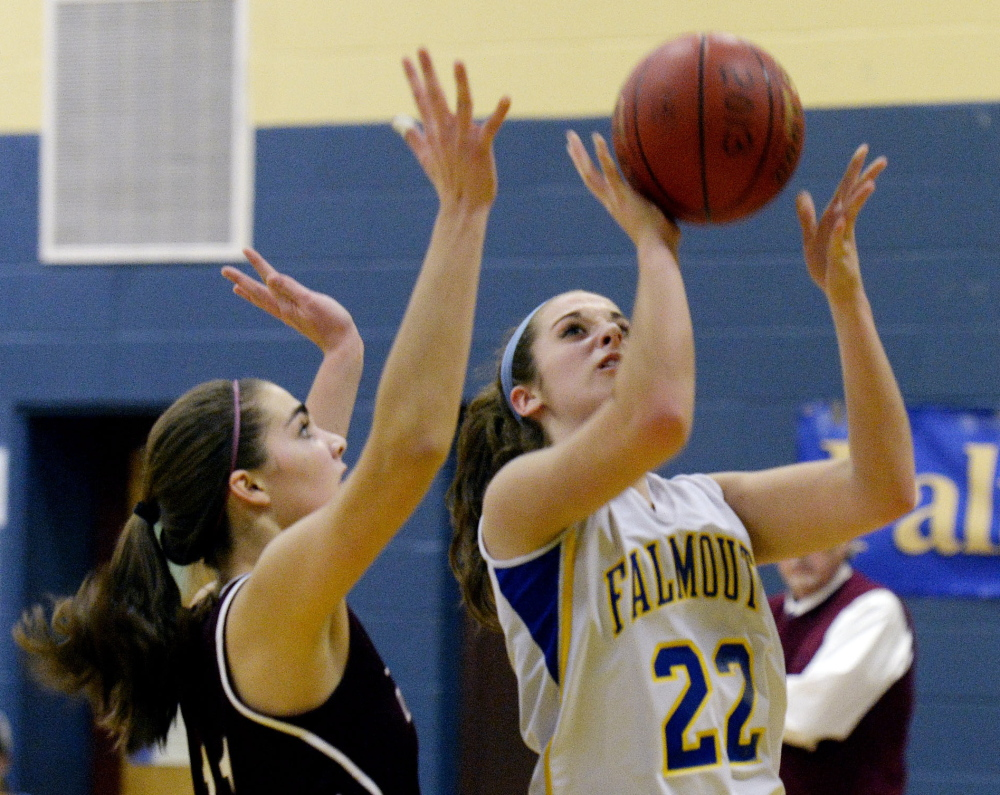 Ally Hickey of Falmouth drives to the basket against Greely's Ashley Storey. Hickey paced the Yachtsmen with 19 points, including four 3-pointers.