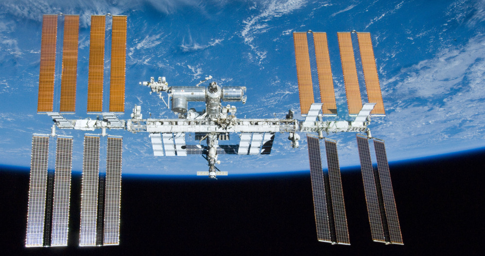 The space station orbits Earth. The breakdown of a pump had forced the astronauts to turn off all nonessential equipment inside the lab, leaving the station in a vulnerable state.