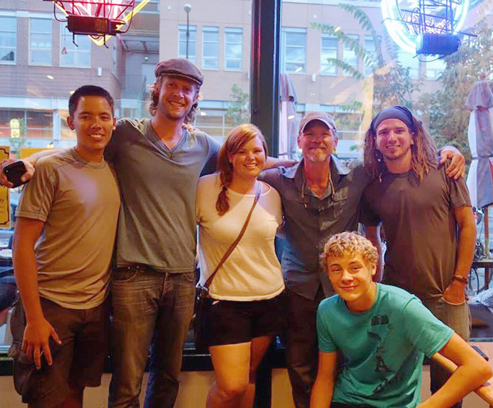 Transcontinental walkers, from left, Benjamin Lee, Jonathon Stalls, Lacey Champion, Joe Bell, Nate Damm, and kneeling, Bell's son Joseph, gather in Boulder, Colo., last August. At any given time, as many as 20 people are attempting to cross the United States on foot, Damm estimates.