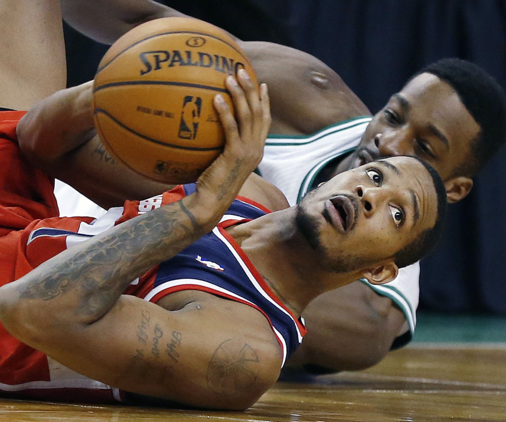 Trevor Ariza of the Washington Wizards looks to the referee after competing with Jeff Green of the Boston Celtics for the ball in the fourth quarter at Boston.