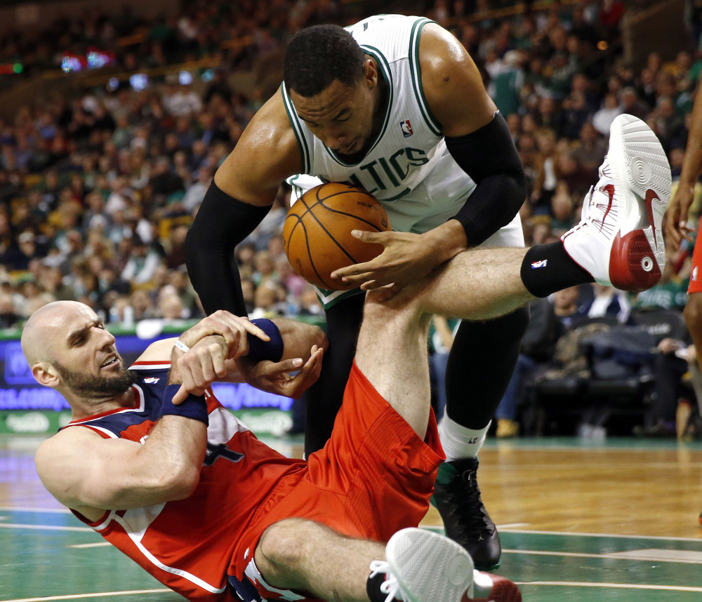 Jared Sullinger of the Boston Celtics, top, attempts to keep the ball away from Marcin Gortat of the Washington Wizards in the third quarter Saturday at Boston. The Wizards came back late for a 106-99 victory.