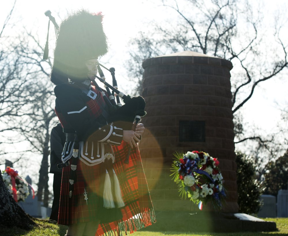 "Bagpiper Ray Bilter plays ""Amazing Grace"" near the Pan Am Flight 103 memorial cairn made of Scottish sandstone at Arlington National Cemetery in Arlington, Va., on Saturday."