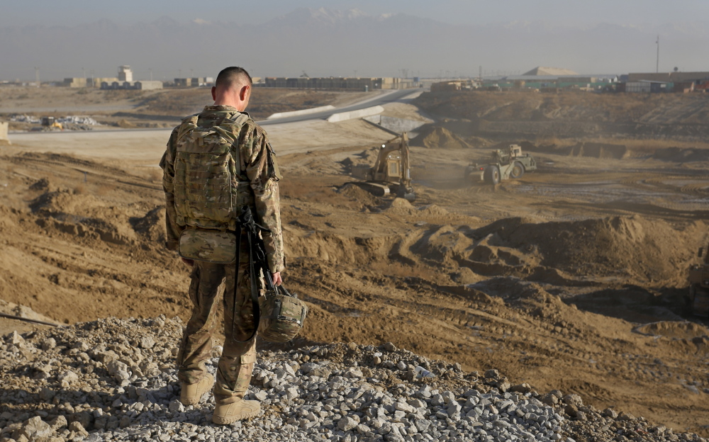 Staff Sgt. Jonathan Boubel of Durham takes a break at Bagram Air Field in Afghanistan on Friday. He is with the 133rd Engineer Battalion of the Maine Army National Guard, which is focused on the end of a military presence that dates back almost to 9/11.