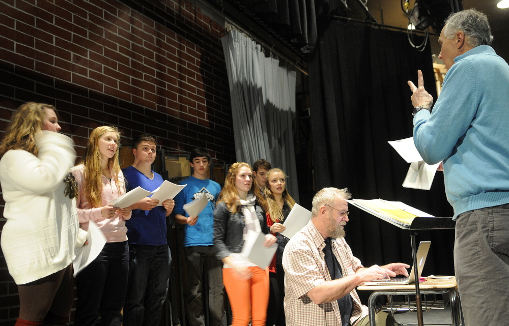 Larry Morissette, right, directs choral students at Hall-Dale High School in Farmingdale as Stan Keach, center, of Rome records the group singing his songs.