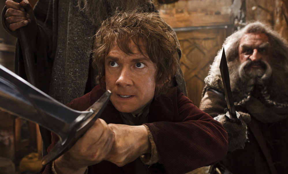 """Martin Freeman, left, and John Callen star in a scene from """"The Hobbit: The Desolation of Smaug."""""""