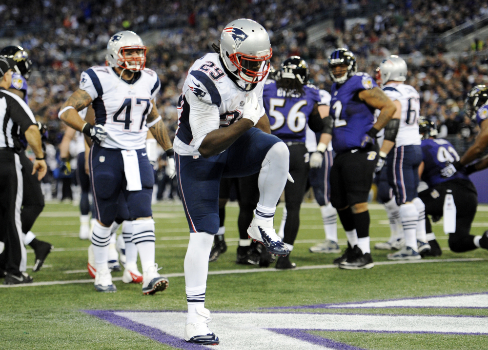 New England Patriots running back LeGarrette Blount (29) celebrates after scoring a touchdown in the first half against the Baltimore Ravens on Sunday.