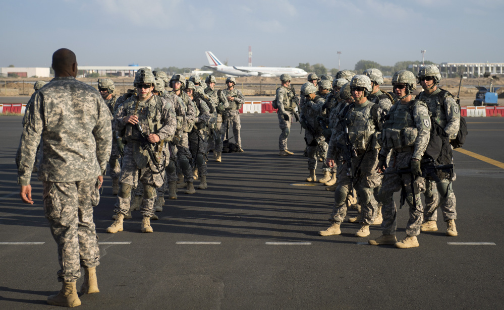 In this photo taken Wednesday, Dec. 18, 2013 and released by the U.S. Air Force, soldiers of the East Africa Response Force (EARF), a Djibouti-based joint team assigned to Combined Joint Task Force-Horn of Africa, prepare to load onto a U.S. Air Force C-130 Hercules at Camp Lemonnier, Djibouti, to support with an ordered departure of personnel from Juba, South Sudan. Gunfire hit three U.S. military CV-22 Osprey aircraft Saturday, Dec. 21, 2013 trying to evacuate American citizens in Bor, the capital of the remote region of Jonglei state in South Sudan, that on Saturday became a battle ground between South Sudan's military and renegade troops, officials said, with four U.S. service members wounded in the attack.