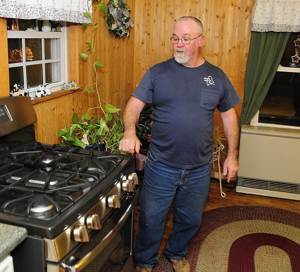 Dick Gagnon expects to save $700 a year by switching from propane to natural gas in his Augusta home.