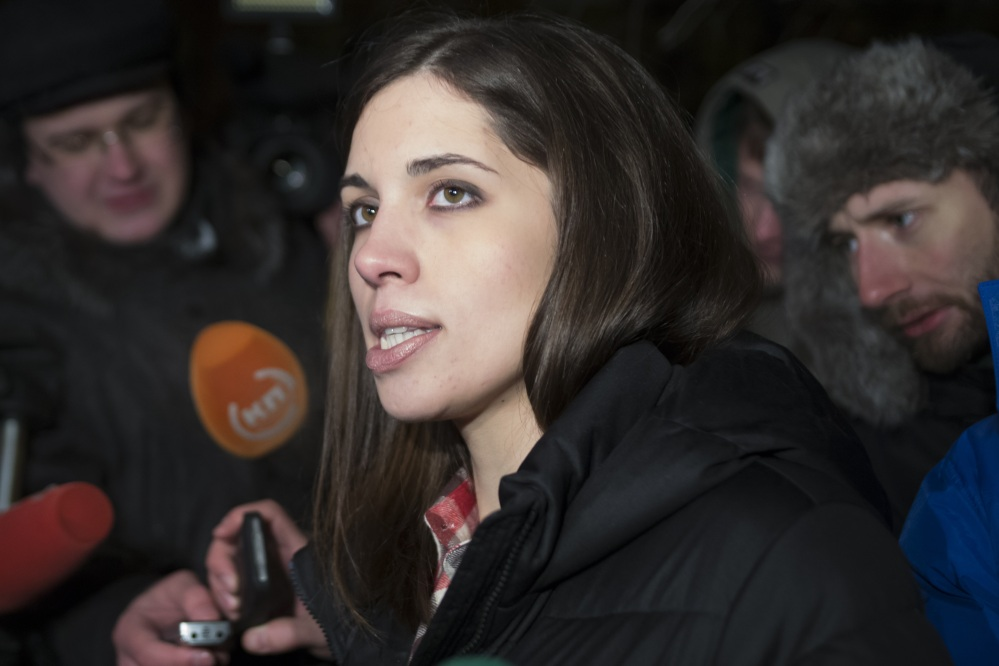 Nadezhda Tolokonnikova of the Russian punk band Pussy Riot speaks to the media after leaving prison Monday. She and bandmate Maria Alyokhina, who was also freed Monday, say they intend to focus on human-right activities.