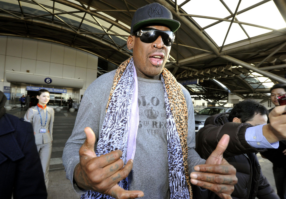Former basketball star Dennis Rodman speaks to journalists upon arrival at the capital airport in Beijing from Pyongyang, North Korea, on Monday.