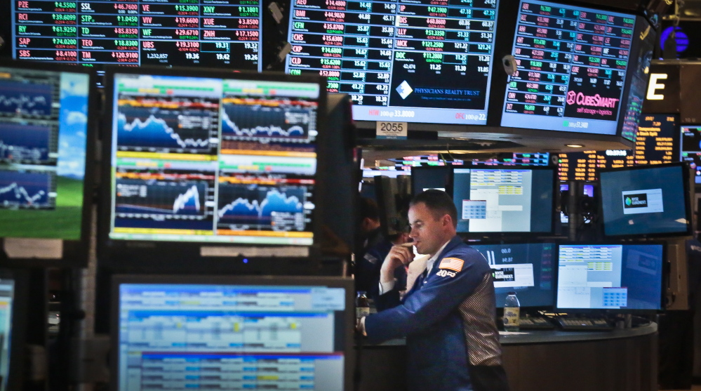 Jason Hardzewicz, a floor official and trader for Barclays, works at his post on the floor of the New York Stock Exchange, in this Aug. 30, 2013, photo. It's been a great year for the average investor, but few market strategists believe that 2014 will be anywhere near as good.