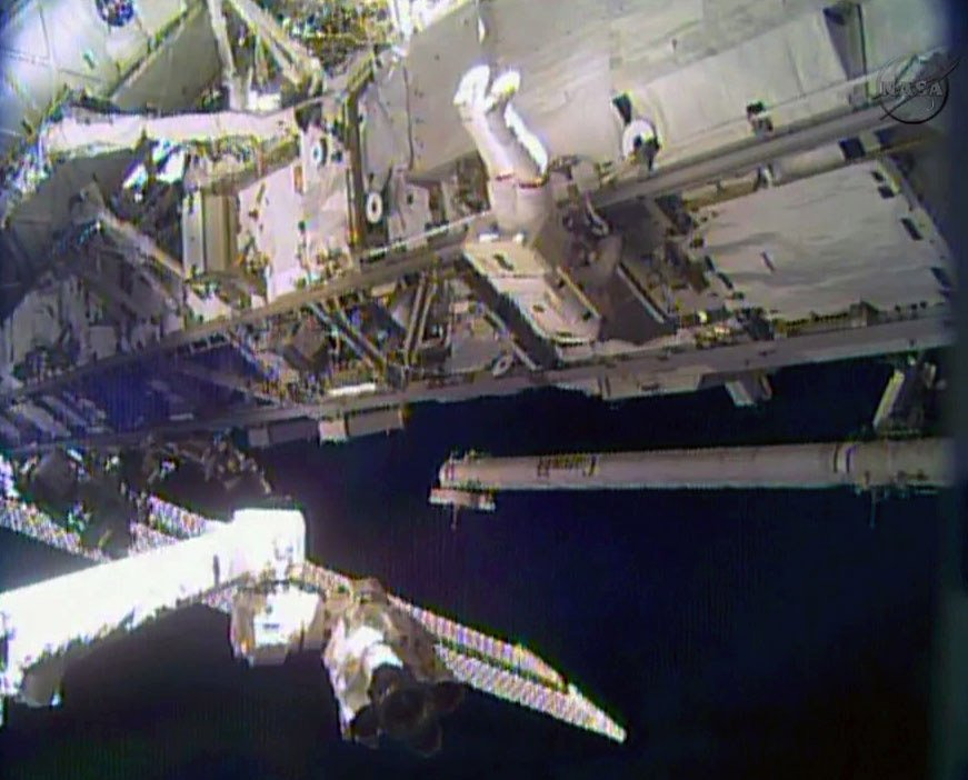 Astronaut Rick Mastracchio performs a space walk outside the International Space Station on Saturday. Mastracchio and Michael Hopkins ventured out of the station to try to revive a crippled cooling line.