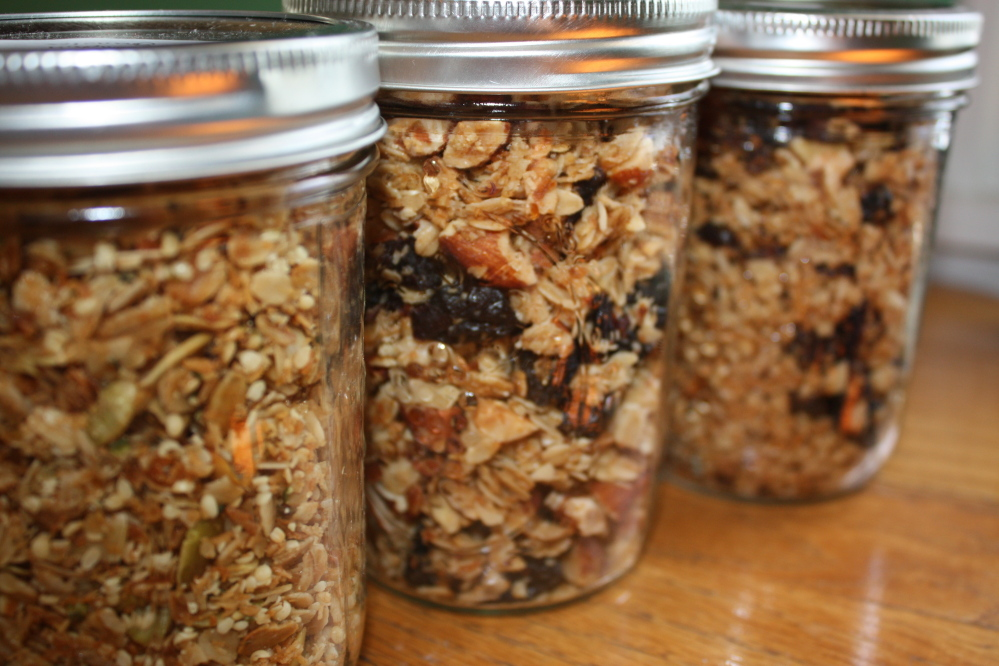 Once it has cooled, store granola in tightly sealed glass jars. From left, the jars contain hemp and pumpkin seed granola, cherry almond granola and cranberry walnut granola.