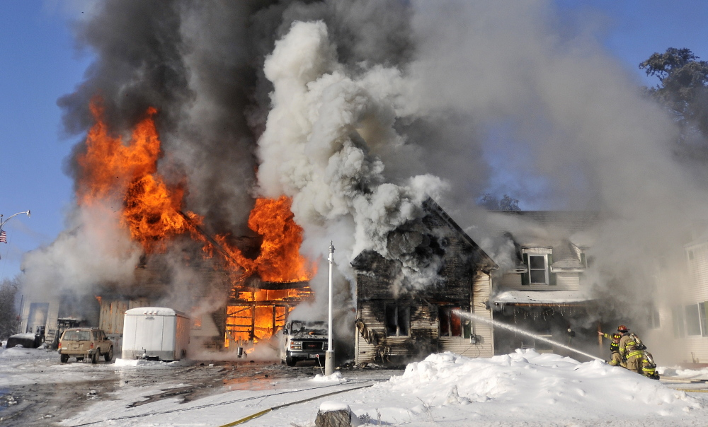 Firefighters from Waterville battle a blaze at 160 Drummond Ave. in Waterville on Wednesday.