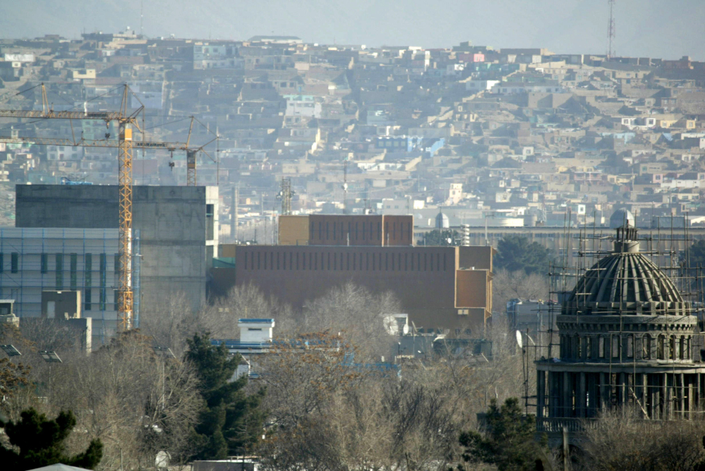A general view of the U.S. Embassy in Kabul, Afghanistan after it was hit by rocket fire in Kabul, Afghanistan, Wednesday, Dec. 25, 2013. The U.S. Embassy in Afghanistan says its compound was hit by indirect fire just before dawn on Christmas Day. It says no Americans were injured.