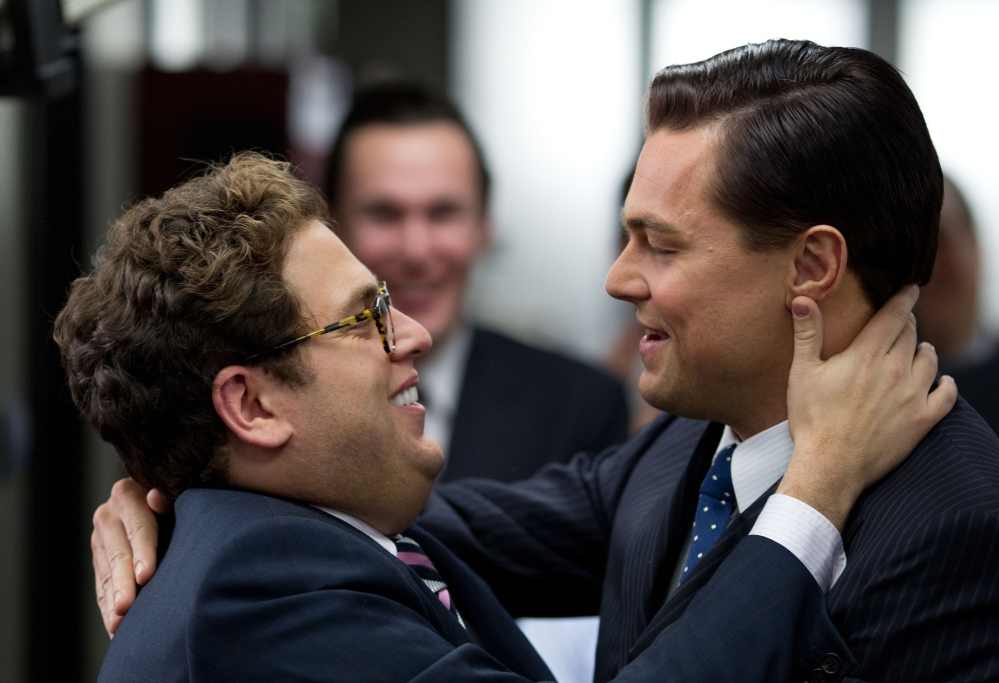 Jonah Hill, left, teams up with DiCaprio in the money chase.