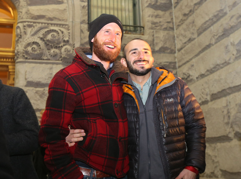 Derek Kitchen, left, and Moudi Sbeity, one of the gay couples that challenged Utah's constitutional definition of marriage as about 1,500 people gather to show support of marriage equality at Washington Square, just outside of the Salt Lake City and County Building Monday, Dec. 23, 2013, in Salt Lake City.