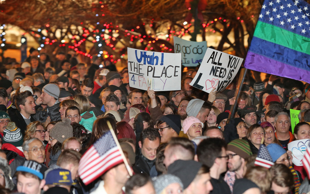 About 1,500 people gather to celebrate marriage equality after a federal judge declined to stay his ruling that legalized same sex marriage in Utah, at Washington Square just outside of the Salt Lake City and County Building Monday, Dec. 23, 2013, in Salt Lake City.
