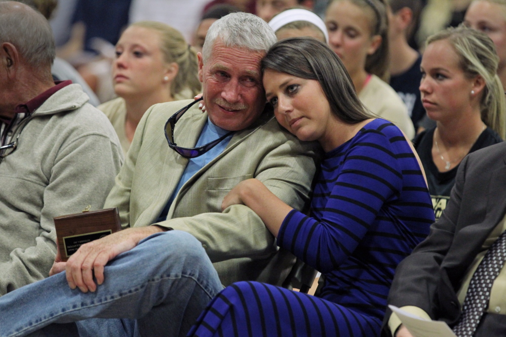 Kayleigh Ballantyne, right, of Gorham, hugs her father, Bruce, during the Opening Convocation at Bryant University in Rhode Island on Sept. 4. Kayleigh received the university's Character Award for her courage in confronting her assailant.