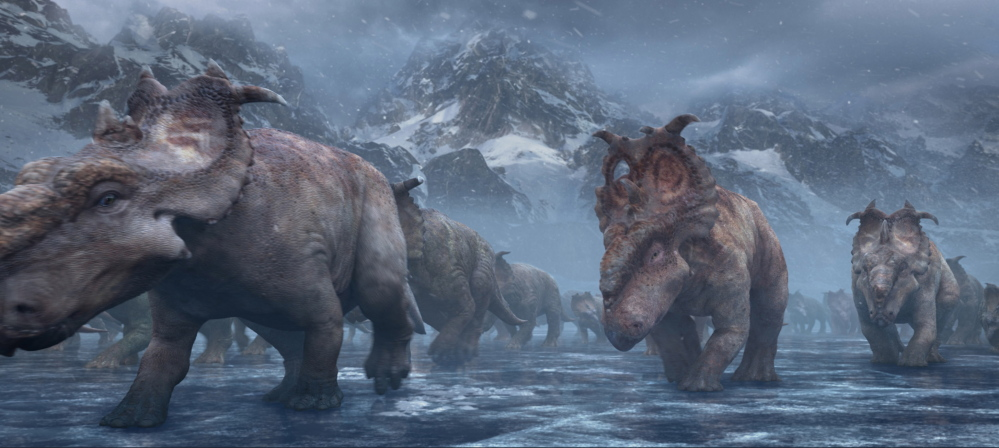"Patchi, center, walks with the herd in a scene from the film ""Walking With Dinosaurs."""
