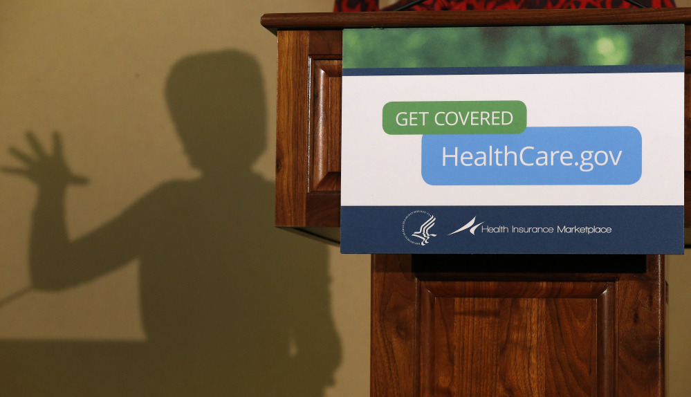 The shadow of Health and Human Services Secretary Kathleen Sebelius is cast on a wall as she speaks at the Community Health and Social Services Center in Detroit last month. President Barack Obama's decision to allow people could keep health insurance policies slated for cancellation under the federal health overhaul has gotten a mixed response from insurers, state regulators and consumers.