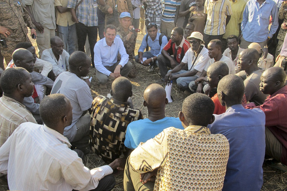 U.N. humanitarian official Toby Lanzer, center-left, visits the U.N. compound where many displaced people have sought shelter in Bentiu, South Sudan, this week.