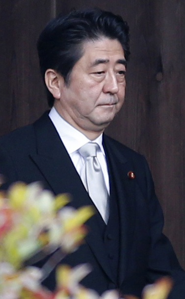Japanese Prime Minister Shinzo Abe walks into Yasukuni Shrine in Tokyo on Thursday.