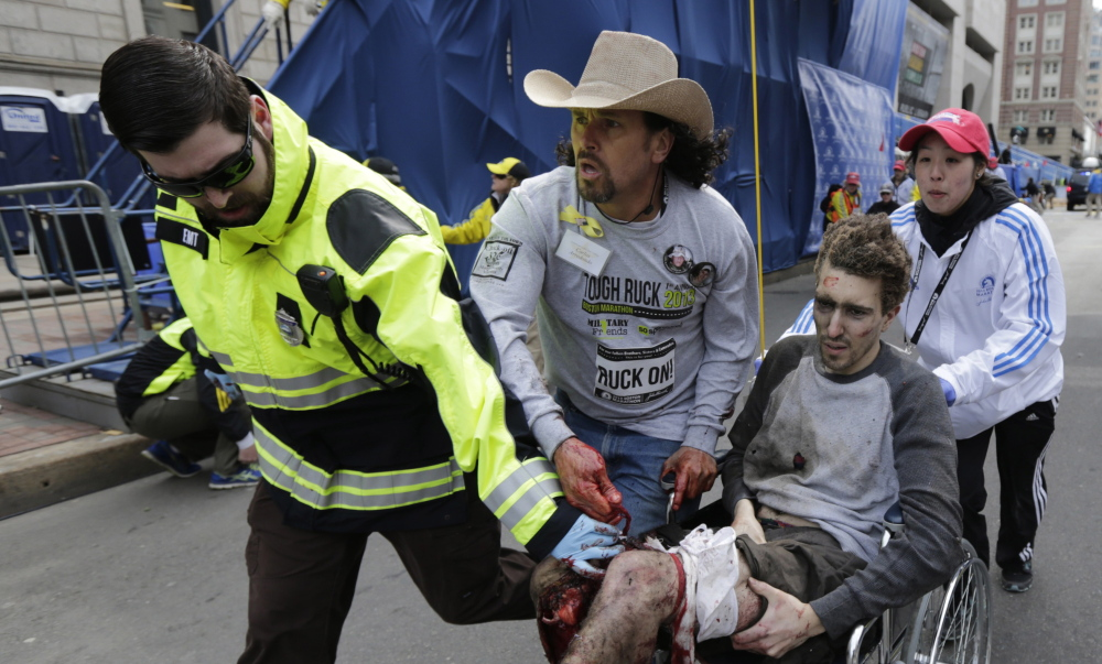 The Boston Marathon bombings that injured Jeff Bauman and so many others was the top sports story of 2013 in an annual Associated Press survey, followed by accounts of legal disputes and arrests.