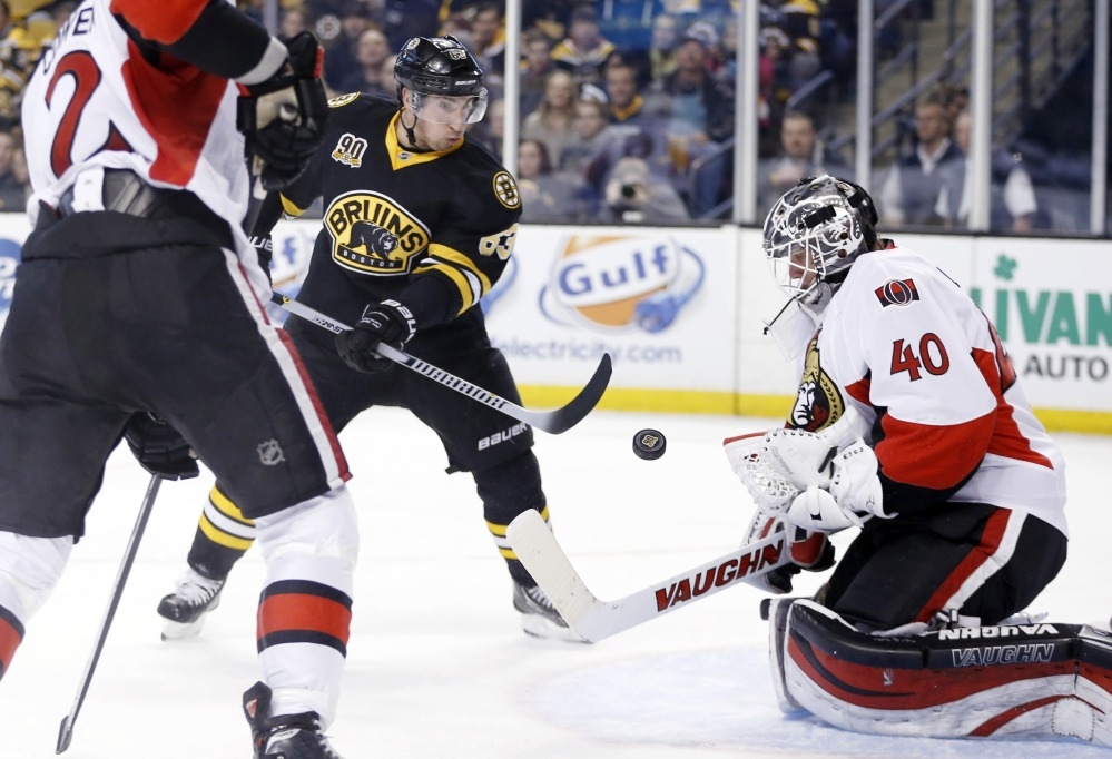 Ottawa Senators' Robin Lehner (40) blocks a shot by Boston Bruins' Brad Marchand (63) in the second period Friday.