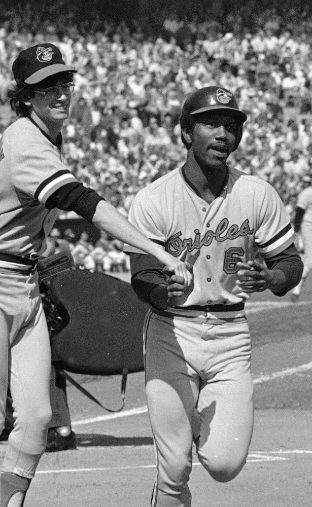 Paul Blair is greeted at the plate after hitting a home run in the opening game against the Oakland Athletics in the American League baseball playoffs in October 1974.