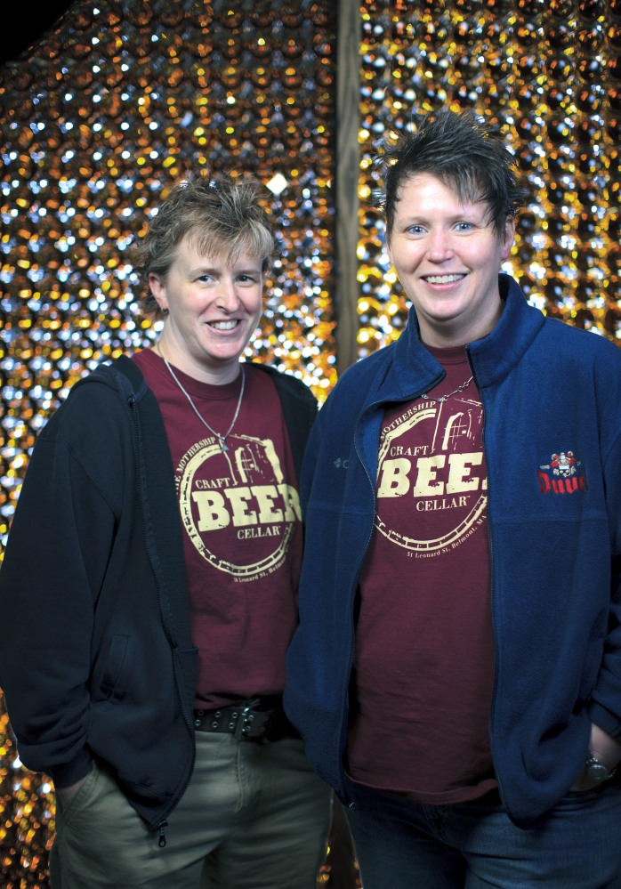 Craft Beer Cellar founders Kate Baker, left, and Suzanne Schalow pose in Newton, Mass.