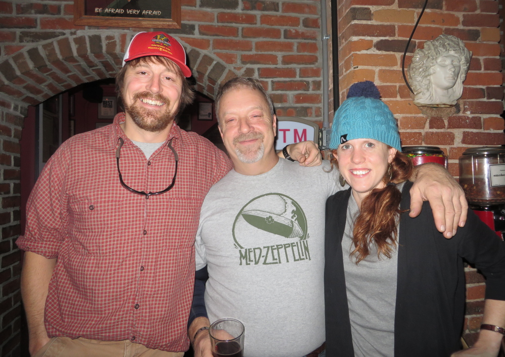 Joe Seremeth of North Yarmouth, Gritty's head brewmaster Andrew Hainer and Kate Gable of North Yarmouth.
