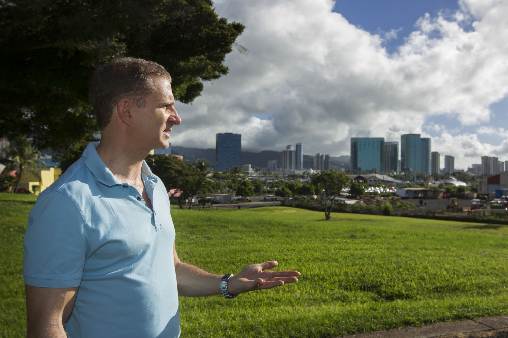 Robert Perkinson, an associate professor at the University of Hawaii at Manoa, talks about the possible location in the Kakaako district of Honolulu to be considered for the Barack Obama Presidential Library in Honolulu. The plot of land can be seen to the far right.