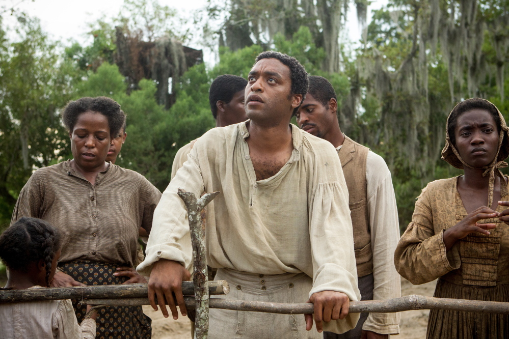 """""""12 Years a Slave,"""" starring Chiwetel Ejiofor, center, is among several films directed by black filmmakers and/or starring black actors that are expected to be in the Oscar race this year."""