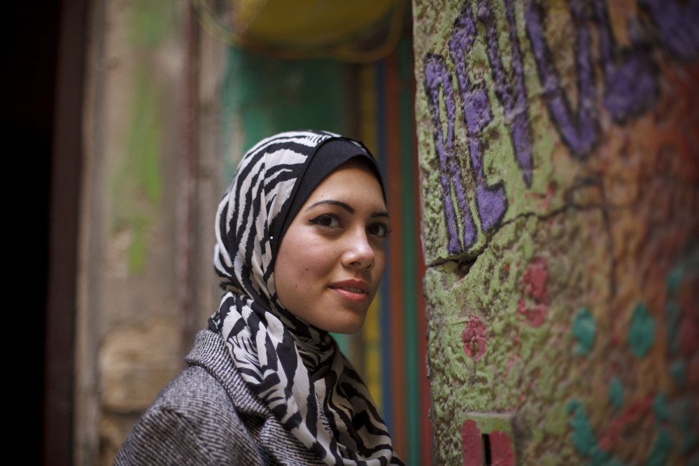 """Rapper Myam Mahmoud, 18, poses for a portrait in Cairo on Dec. 10. """"We cannot stay silent,"""" about challenges facing girls and women, she says."""