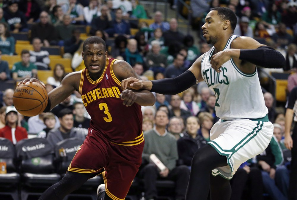 Cleveland Cavaliers' Dion Waiters drives past Boston Celtics' Jared Sullinger in the second quarter Saturday in Boston.